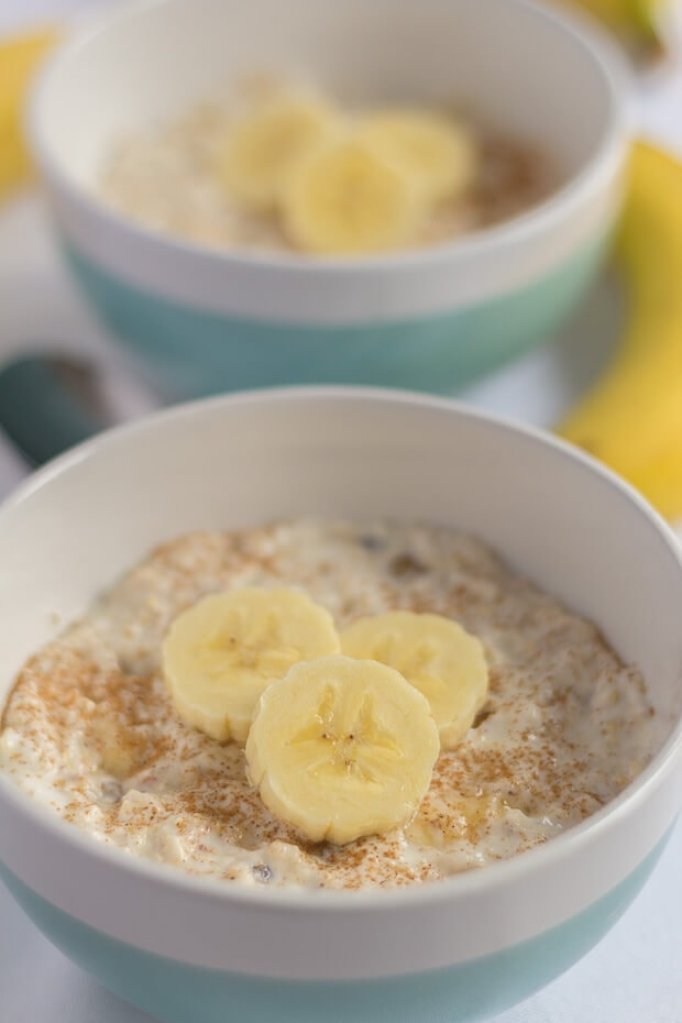 Two bowls of breakfast banana boost. An easy overnight oats recipe decorated with bananas.