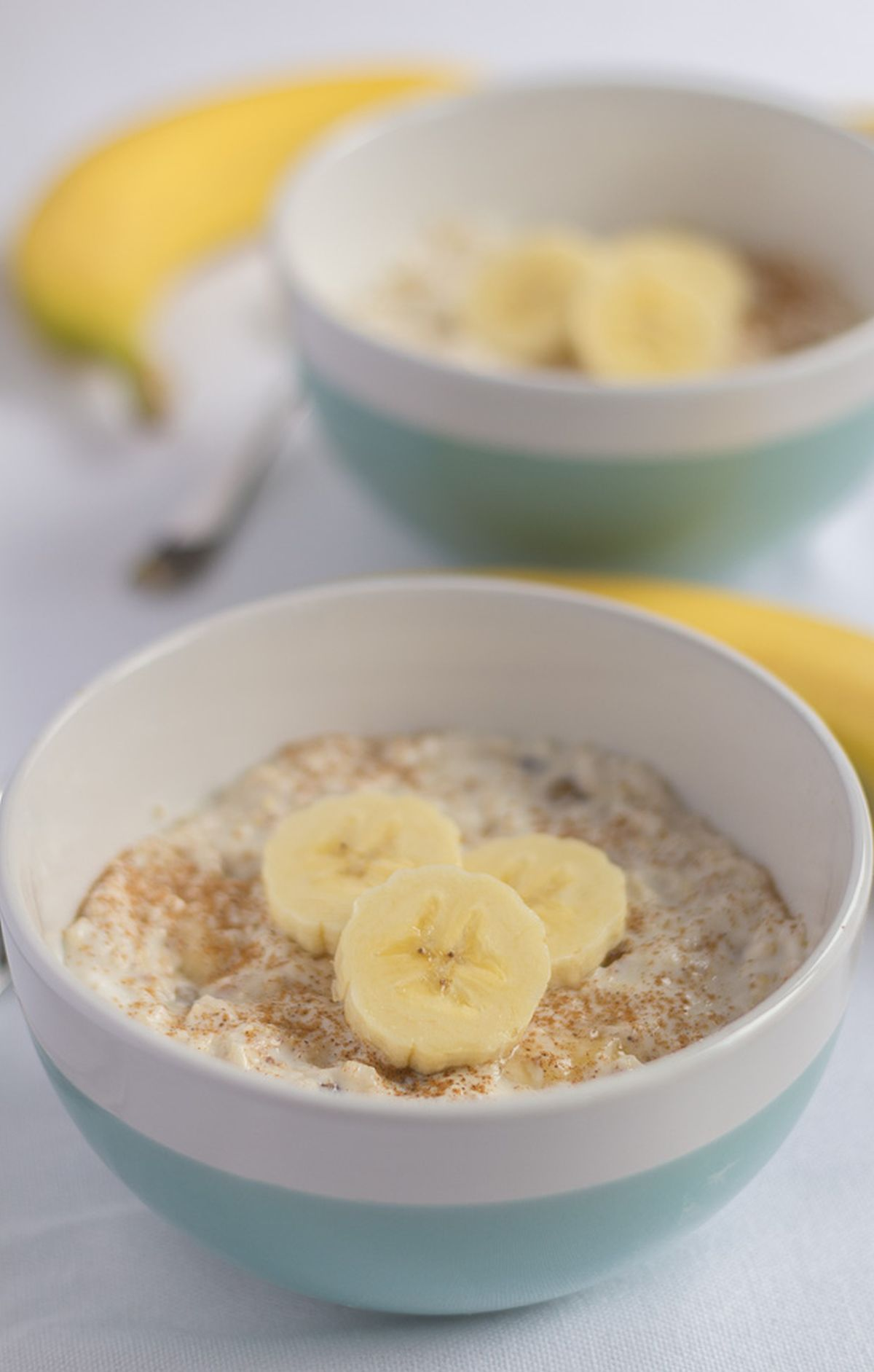 Two bowls of a breakfast banana boost one in front of the other.
