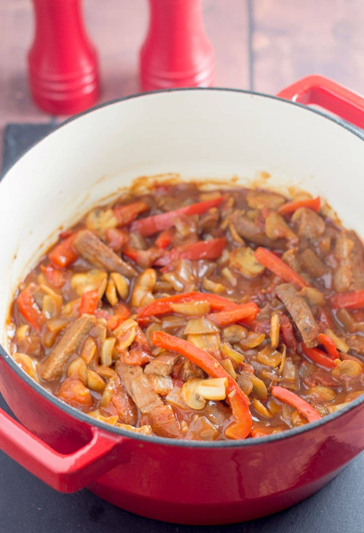 A pot of cooked and ready to serve venison sausage casserole.