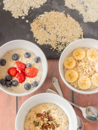 Birds eye view of 3 different types of cooked breakfast porridges. Porridge oats, oatmeal and pinhead oats.