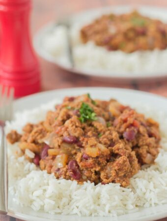 Two plates of Quorn Chilli Con Carne one in front of the other served on a portion of rice.