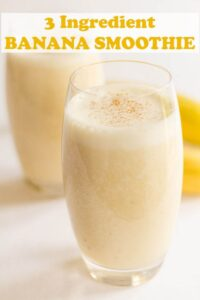 Two glasses of banana smoothie one in front of the other with Pin title at the top.