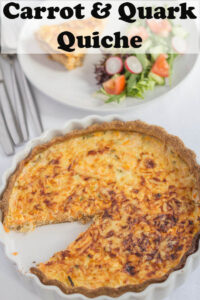 Birds eye view of carrot and quark quiche in a quiche dish with a quarter portion taken out. Pin title at top.