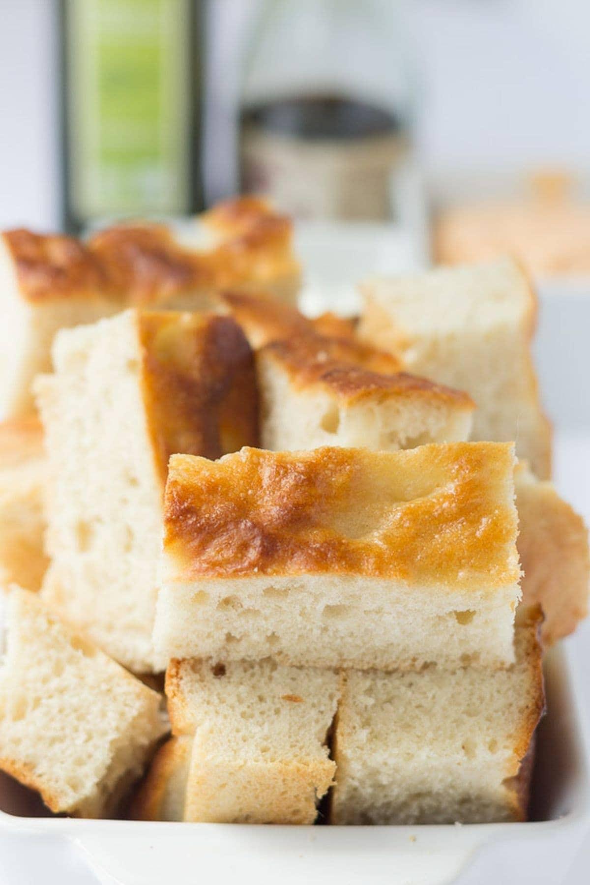 Focaccia bread cut into fingers.