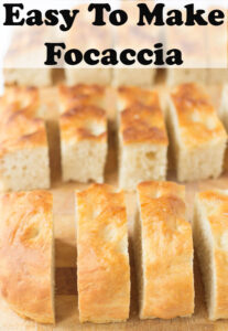 Focaccia sliced into finger sizes on a breadboard. Pin title at top.