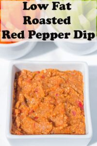 Low fat roasted red pepper dip in a white serving dish.