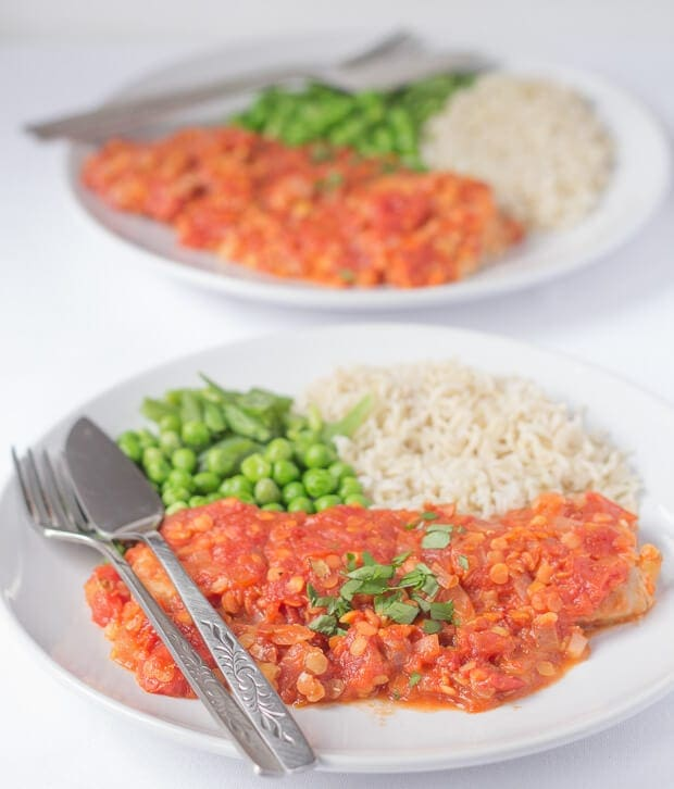 Spicy fish plaki is a low cost quick healthy meal where white fish fillets are covered with a spicy Indian Dahl fish topping made from lentils and tomatoes and then baked. All in just 30 minutes!