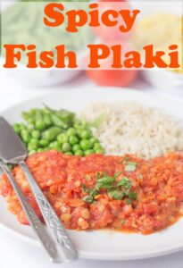 Spicy fish plaki served with rice and peas.