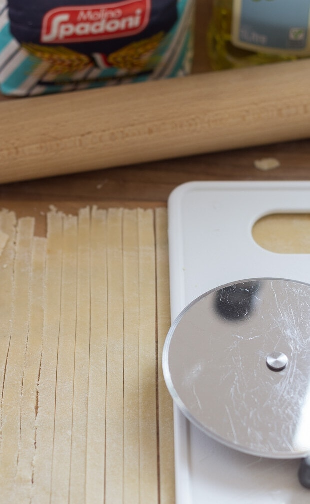 Make your own tagliatelle with home-made pesto step 4. Pasta being cut up into strips with a pizza cutter.