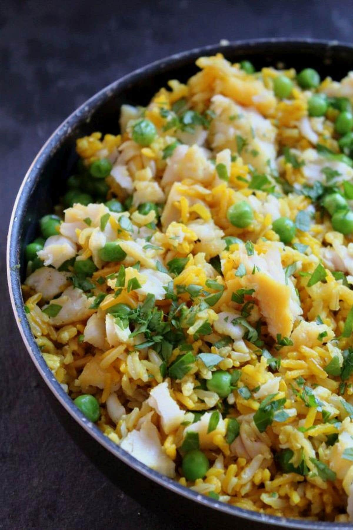 Birds eye view of a pan of cooked kedgeree ready to serve.