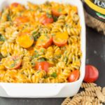 Oven baked whole wheat pesto fusilli is just perfect if you're looking for a quick healthy meal. It's just a simple pesto sauce combined with healthy whole grains and juicy tomatoes to give you a taste of the Mediterranean.