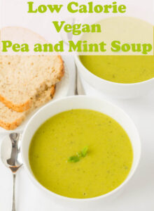 Two bowls of pean and mint soup with a plate of homemade bread to the side.