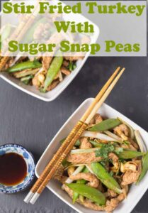 Birds eye view of two square bowls of stir fry turkey with sugar snap peas and chop sticks to the side. Pin title text overlay at top.