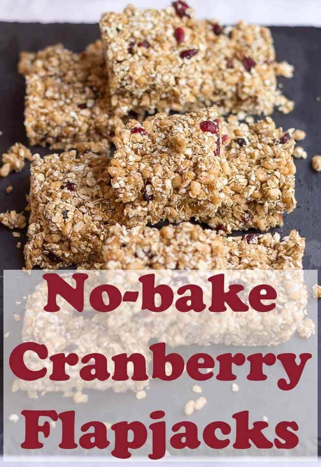 No bake cranberry flapjacks. Delicious chewy and packed full of healthy oats nuts, almond butter and cranberries. This easy recipe is minimum effort too as absolutely no baking is required! #neilshealthymeals #recipe #cranberry #flapjacks