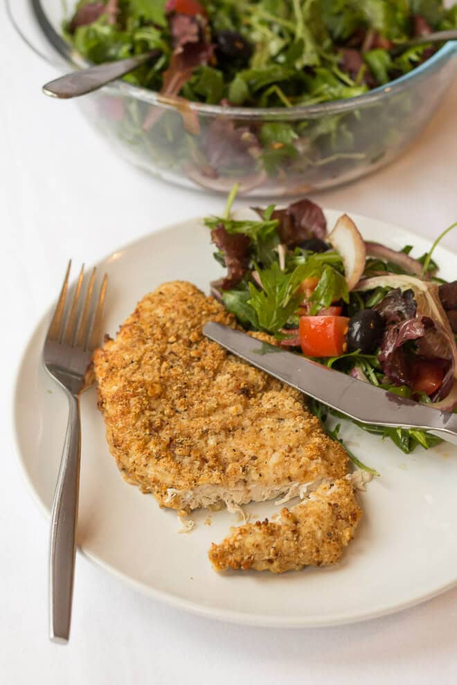 These baked parmesan turkey escalopes are delicious and such a great quick healthy meal to make. A crunchy baked breadcrumb and parmesan crusted turkey breast with a delightful and a simple tomato and rocket side salad all in under an hour. Say goodbye to shop bought and hello to home made!