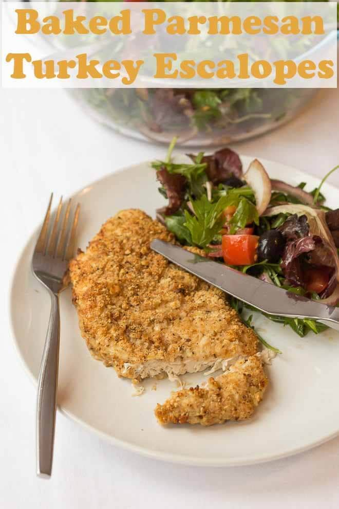 These baked parmesan turkey escalopes are delicious and such a great quick healthy meal to make. A crunchy baked breadcrumb and parmesan crusted turkey breast with a simple tomato and rocket side salad made in under an hour! #neilshealthymeals #recipe #turkey #turkeyescalopes