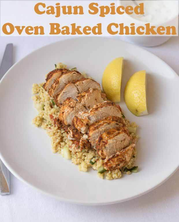 Cajun spiced oven baked chicken is an easy low cost lean and tasty quick healthy meal. This time-saving recipe comes with a delicious bulgur wheat, tomato and cucumber side salad and makes for an excellent lunch or dinner. #neilshealthymeals #recipe #cajun #chicken #ovenbaked