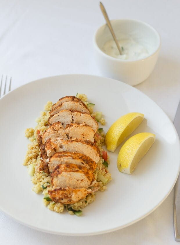 Cajun spiced oven baked chicken is a low cost, lean and tasty quick healthy meal. With a delicious bulgur wheat, tomato and cucumber side salad this recipe makes for an excellent mid-week dinner or lunch option for 2!