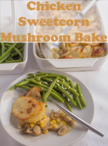 Chicken Sweetcorn and Mushroom bake served on a plate with green beans side. The rest of the casserole dish in the background.