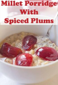 A bowl of spiced plumb millet porridge with slices of plums on top and a spoon in. Pin title text overlay at top.