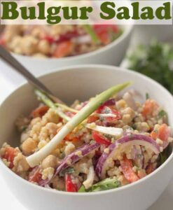 Two bowls of bulgur salad one in front of the other. Pin title text overlay at top.