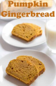 Two plates with two slices of pumpkin gingerbread on. One in front of the other with a glass of milk in bewtween. Pin title text overlay at top.