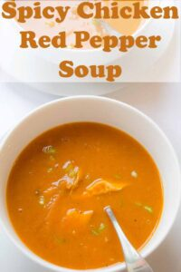 Birds eye view of a bowl of spicy chicken and red pepper soup with a spoon in. Pin title text overlay at top.
