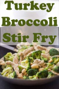 A wok with cooked turkey and broccoli stir fry in. Pin title text overlay at top.