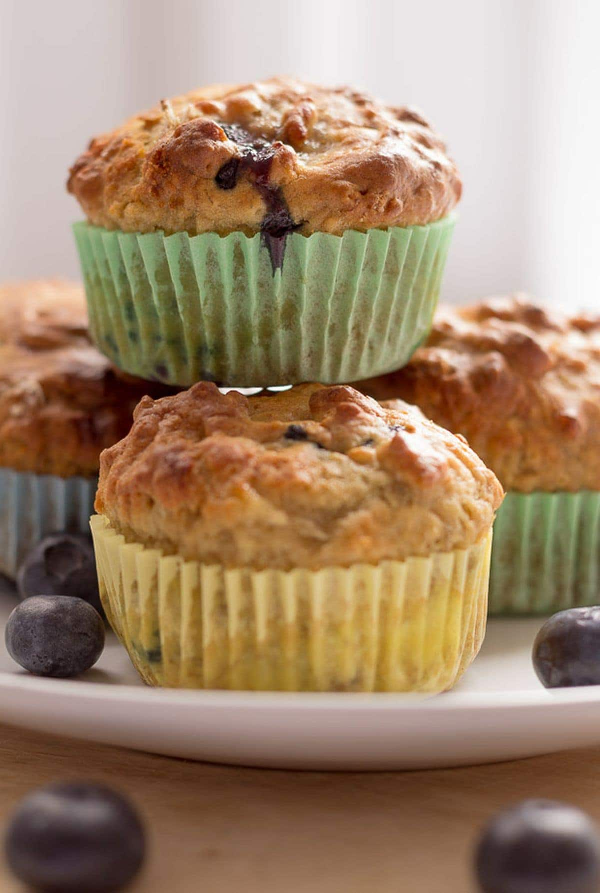 Close up of a plate of banana blueberry breakfast muffins.