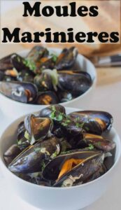 Two bowls of moules marinieres one in front of the other garnished with chopped parsley. Pin title text overlay at top.