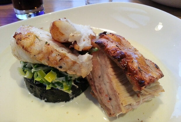 Pan seared monkfish with pork belly black pudding and creamed leeks