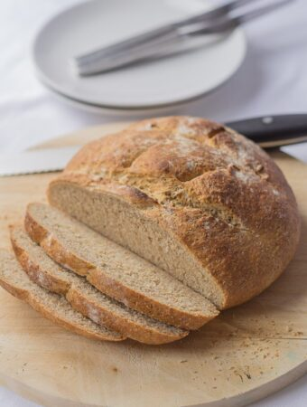 A traditional cob loaf. The perfect mopping up accompaniment for soups and meat and fish stews. If you've never made your own bread before then don't worry, this wholemeal cob loaf is an easy mixed by hand in one bowl bread. No fancy bread machines or machine mixers required, just good old muscle-building hand kneading.