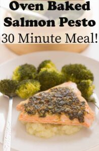 Oven baked salmon pesto on a bed of mash with broccoli florets in the background. Pin title text overlay at top.