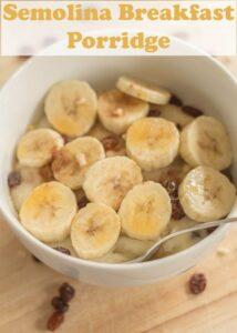 Birds eye view of a bowl of semolina breakfast porridge decorated with sliced bananas.