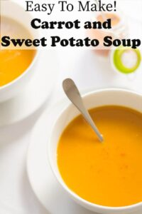 Two bowls of carrot and sweet potato soup.