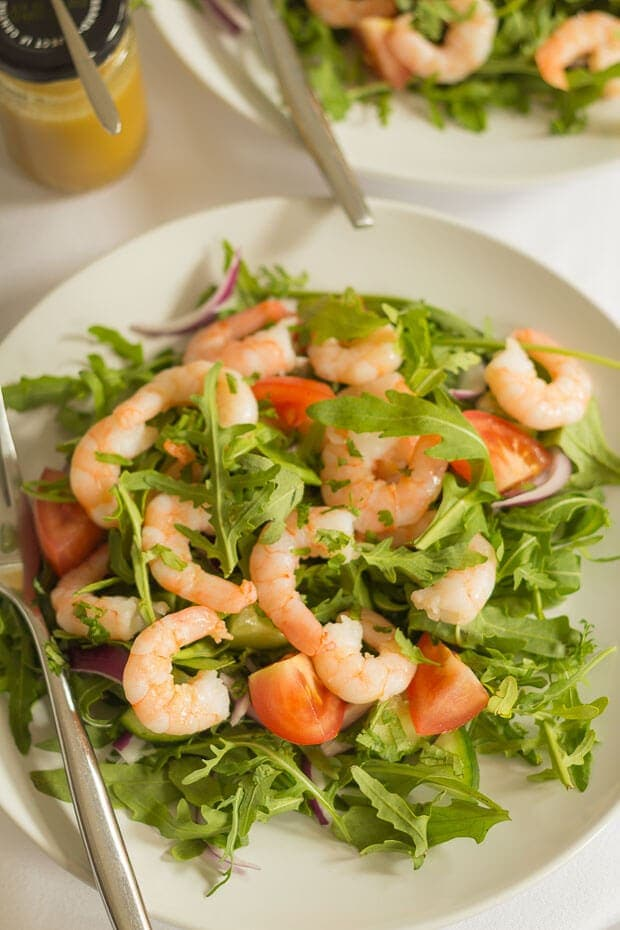 Birds eye view of a plate of prawn salad with a fork on.