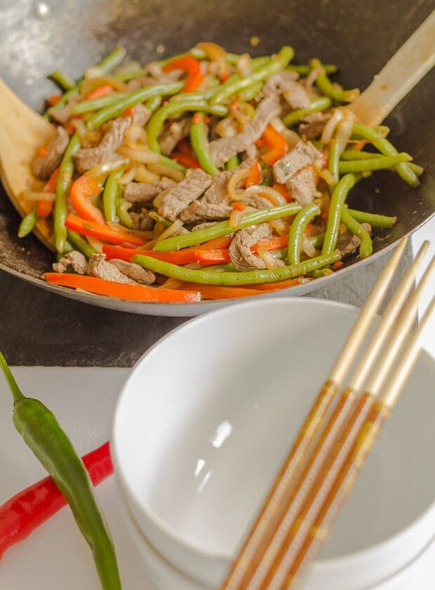 Chilli beef stir fry. Thin strips of steak, pepper and green beans and a tasty combination of sauces combined make up this sensational easy, healthy stir fry.