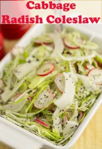Close up of a dish of cabbage and radish coleslaw. Pin title text overlay at top.