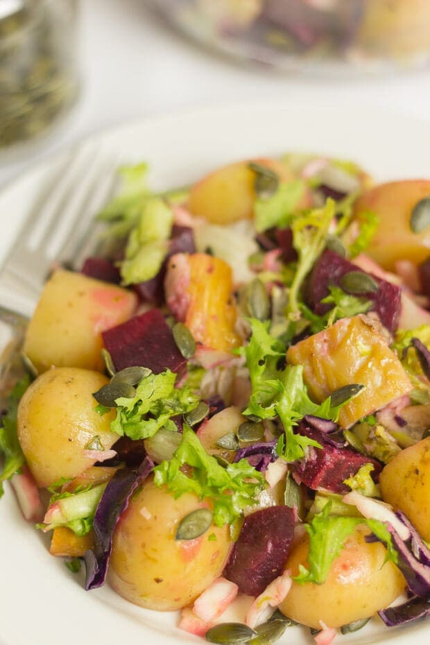 Close up of a plate of mackerel beetroot salad.