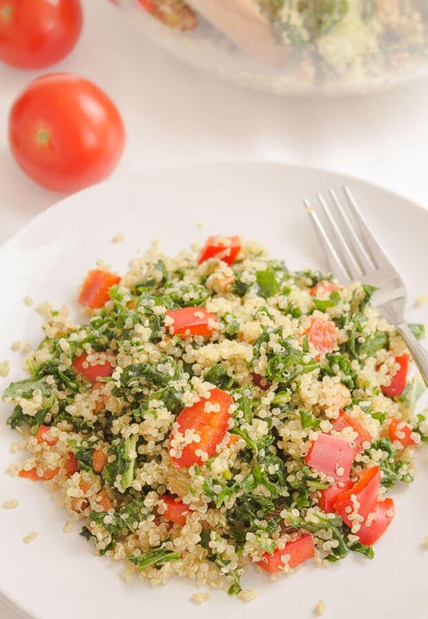 Close up of a plate of served quinoa kale almond salad.
