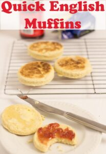 Two quick English muffins on a plate. One with jam on and a bite taken out of. A wire baking rack with three muffins on in the background. Pin title text overlay at top.