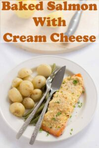 Birds eye view of a plate with baked salmon with cream cheese on. Pin title text overlay at top.