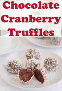 A plate of 5 chocolate cranberry truffles with one cut in half.