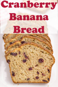 A loaf of sliced cranberry banana bread.