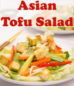 A plate of Asian tofu salad with chop sticks.