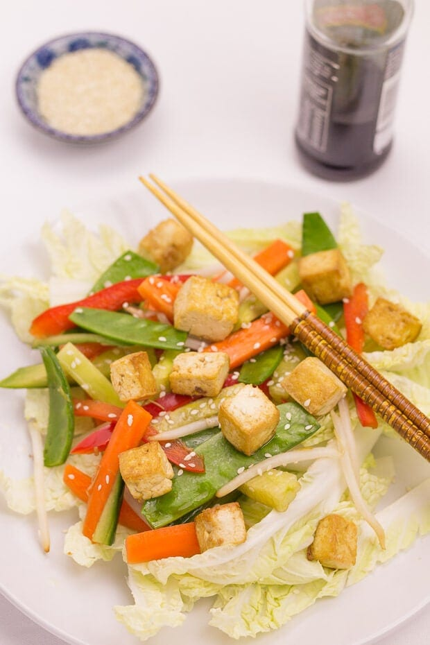 Asian tofu salad is simple and delicious. Sesame marinated tofu with a zingy balsamic soy dressed salad makes for a fantastic and easily prepared vegan quick healthy meal! You'll love the combination of these far eastern flavours and fresh ingredients!