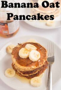 A plate of banana oat pancakes topped with sliced bananas and honey. A fork to the side. Pin title text overlay at top.