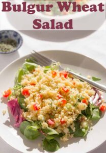 A plate of bulgur wheat salad. Pin title text overlay at top.