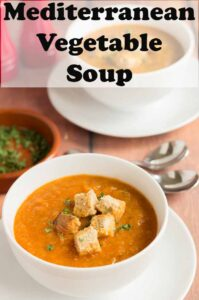 A bowl of Mediterranean vegetable soup garnished with croutons. Pin title text overlay at top.