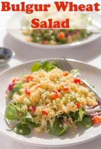 Two plates of bulgur wheat salad one in front of the other.
